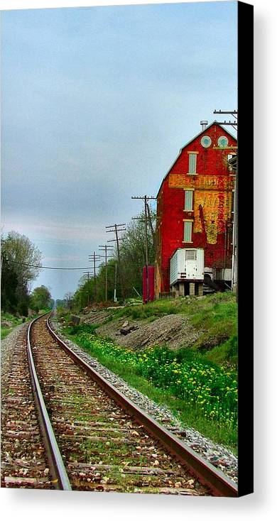 Old Feed Mills Canvas Print featuring the photograph Old Mill On The Tracks by Julie Dant