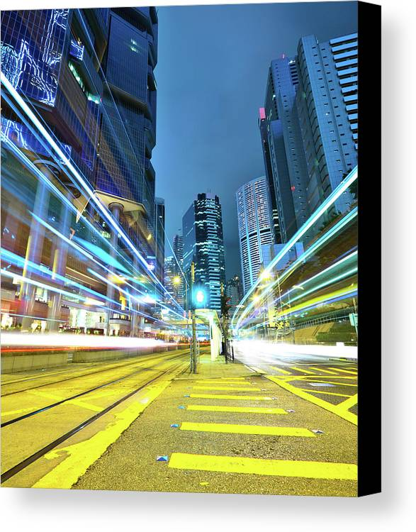 Vertical Canvas Print featuring the photograph Traffic Trails In City by Leung Cho Pan