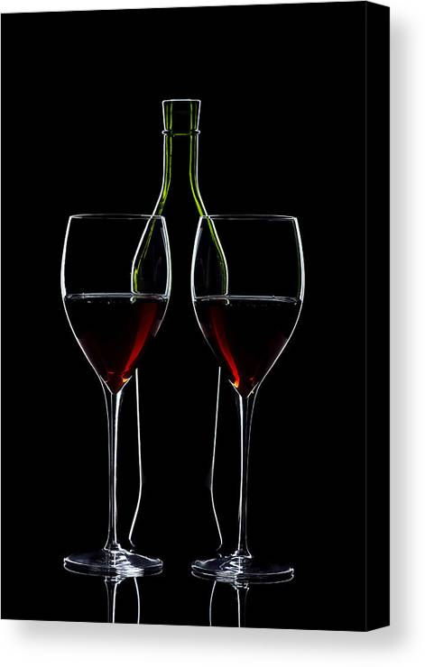 Wine Canvas Print featuring the photograph Red Wine Bottle And Wineglasses Silhouette by Alex Sukonkin