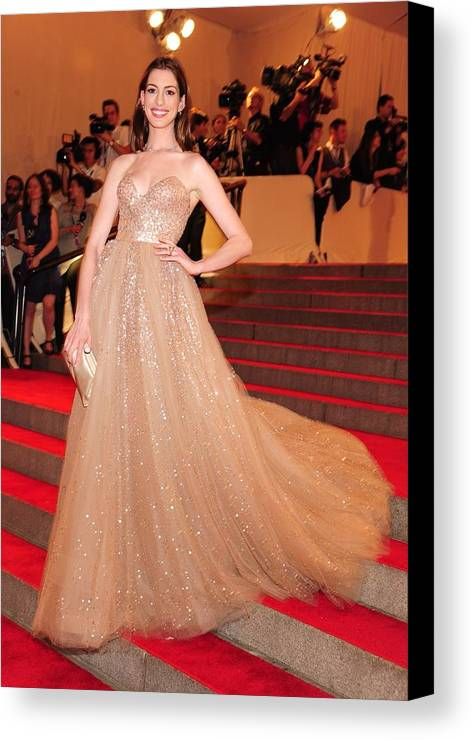 Anne Hathaway Canvas Print featuring the photograph Anne Hathaway Wearing A Valentino Gown by Everett