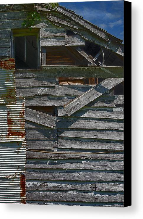 There Are Many Layers Of Material On This Old House. Canvas Print featuring the photograph Building Materials by Murray Bloom