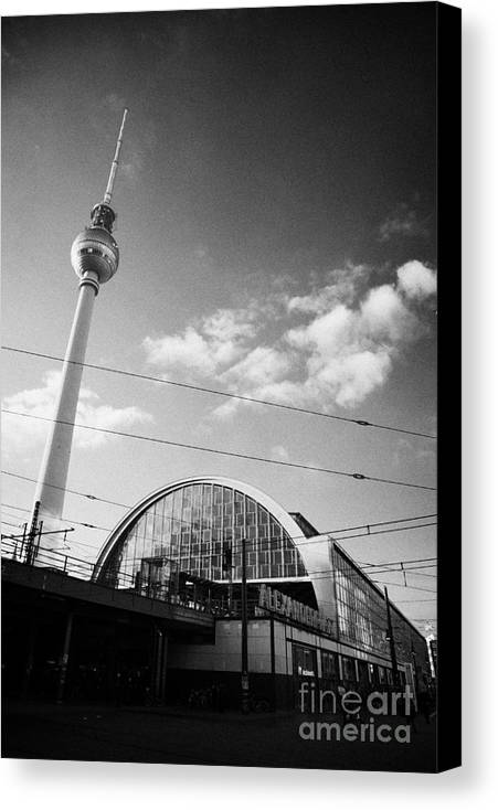 Berlin Canvas Print featuring the photograph berliner fernsehturm Berlin TV tower symbol of east berlin and the Alexanderplatz railway station by Joe Fox
