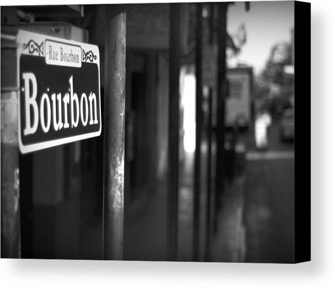 \bourban Street\ Canvas Print featuring the photograph Rue Bourbon by John Gusky