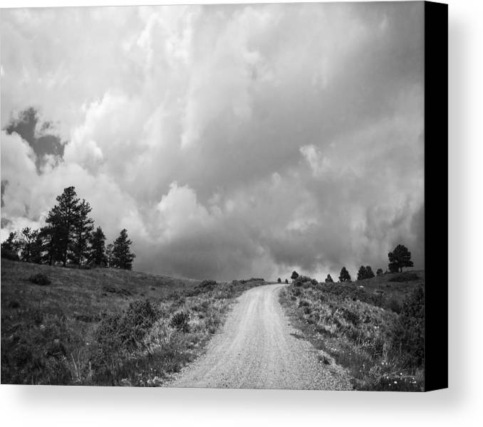 Black And White Canvas Print featuring the photograph Country Road With Stormy Sky In Black And White by Julie Magers Soulen