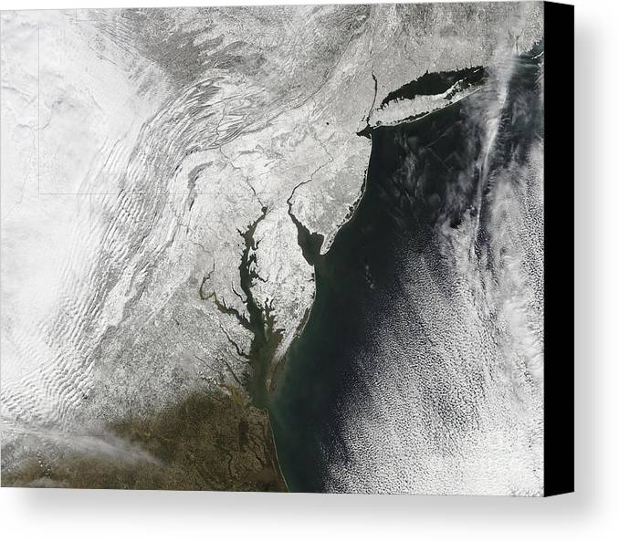 Blizzard Canvas Print featuring the photograph A Severe Winter Storm Along The United by Stocktrek Images