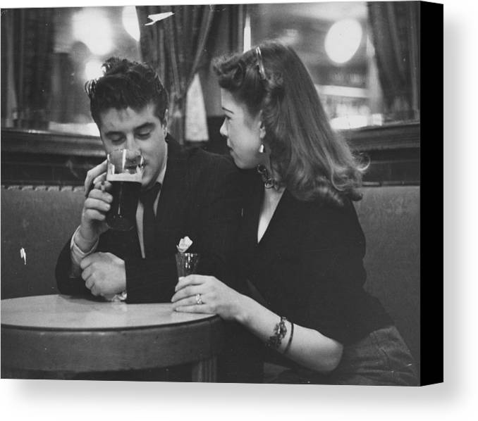 16-17 Years Canvas Print featuring the photograph Couple In Pub by Picture Post