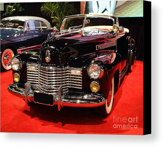 1941 Cadillac Series 62 Convertible Coupe Canvas Print featuring the photograph 1941 Cadillac Series 62 Convertible Coupe . Front Angle by Wingsdomain Art and Photography