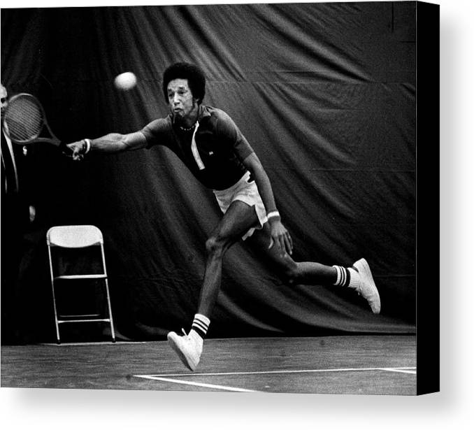Retro Images Archive Canvas Print featuring the photograph Arthur Ashe Returning Tennis Ball by Retro Images Archive
