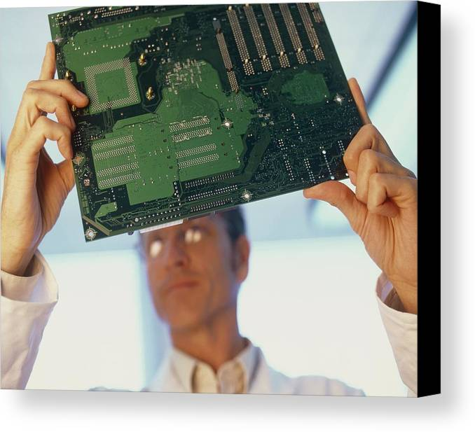 Human Canvas Print featuring the photograph Electronics Engineer by Adam Gault