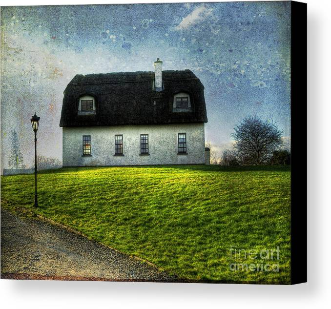 Accommodation Canvas Print featuring the photograph Irish Thatched Roofed Home by Juli Scalzi