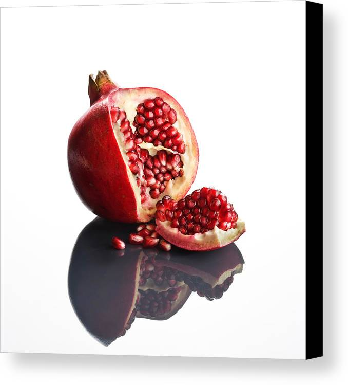 Pomegranate Canvas Print featuring the photograph Pomegranate Opened Up On Reflective Surface by Johan Swanepoel