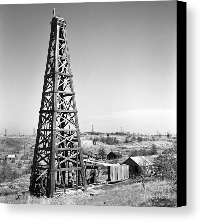 Oilfield Canvas Print featuring the photograph Old Wooden Derrick by Larry Keahey