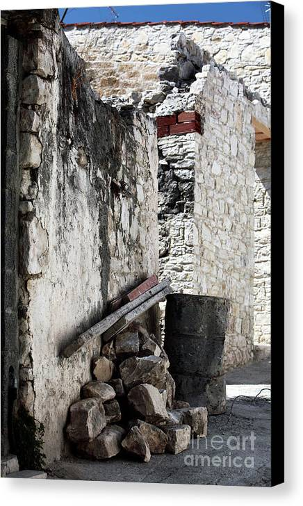Working In Cyprus Canvas Print featuring the photograph Working In Cyprus by John Rizzuto
