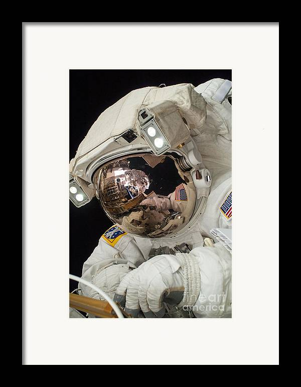 Space Framed Print featuring the photograph Iss Expedition 38 Spacewalk by Science Source