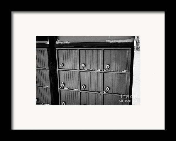 Canada Framed Print featuring the photograph canada post post mailboxes in rural small town Forget Saskatchewan Canada by Joe Fox