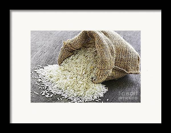 Rice Framed Print featuring the photograph Long Grain Rice In Burlap Sack by Elena Elisseeva