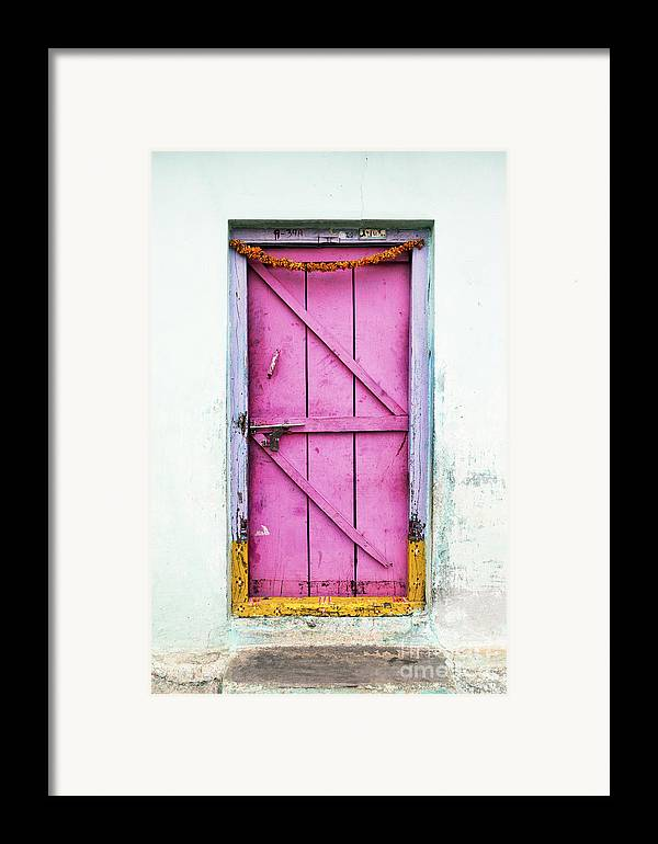 Old Framed Print featuring the photograph A Pink Door by Tim Gainey
