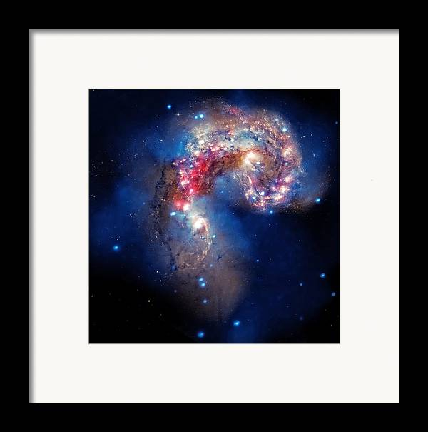 Universe Framed Print featuring the photograph Antennae Galaxies Collide 2 by The Vault - Jennifer Rondinelli Reilly
