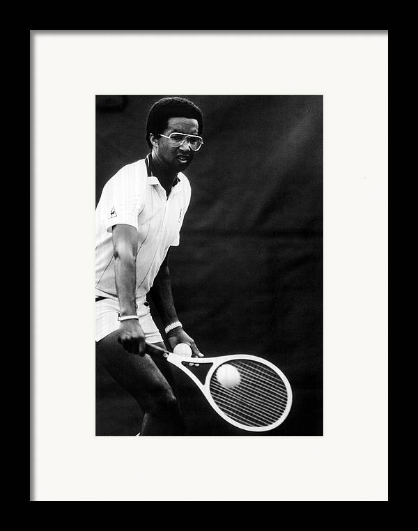 Retro Images Archive Framed Print featuring the photograph Arthur Ashe Playing Tennis by Retro Images Archive