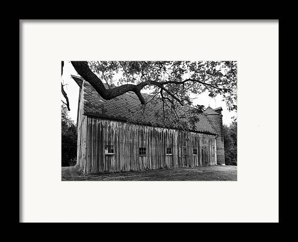 Old Barns Framed Print featuring the photograph Barn With Brick Silo In Black And White by Julie Dant