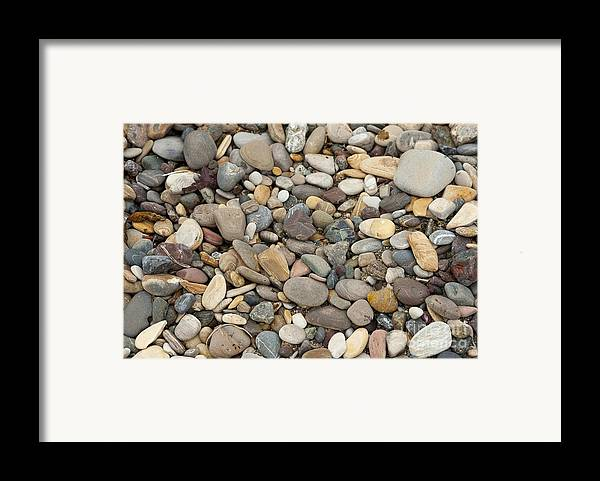 Ocean Framed Print featuring the photograph Beach Rocks by Artist and Photographer Laura Wrede
