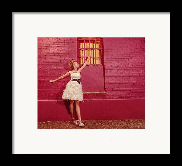 People Framed Print featuring the photograph Classy Diva Standing In Front Of Pink Brick Wall by Kriss Russell