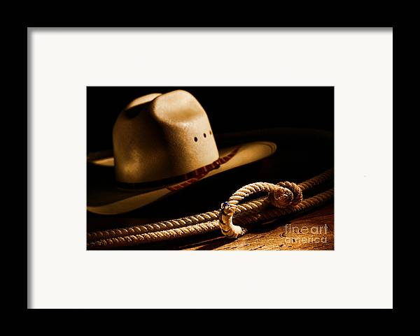 Western Framed Print featuring the photograph Cowboy Hat And Lasso by Olivier Le Queinec