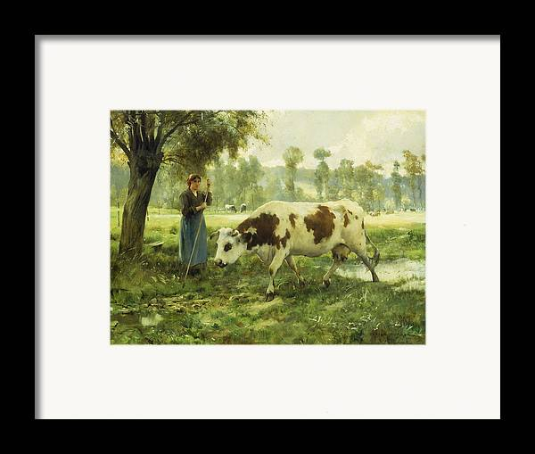 Cows; Cow; Cattle; Pasture; Pastoral; Cowherd; Female; Woman; Farmer; Farming; Labor; Laborer; Remote; Rural; Landscape; Agriculture; Agricultural; Livestock; Countryside; Farm; Animal; Animals; Green; Lush; Field; Fields; French; Provincial; Labor; Shade; Shadow; Tree Framed Print featuring the painting Cows At Pasture by Julien Dupre