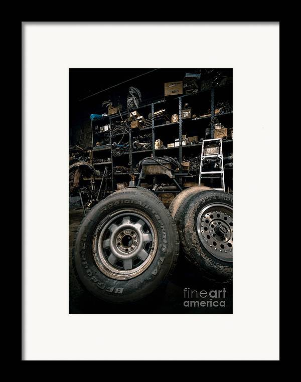 Equipment Framed Print featuring the photograph Dark Old Garage by Amy Cicconi