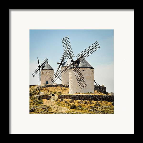 Spain Framed Print featuring the photograph Don Quixote's Windmills by Tetyana Kokhanets