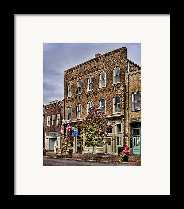 General Store Framed Print featuring the photograph Dowtown General Store by Heather Applegate