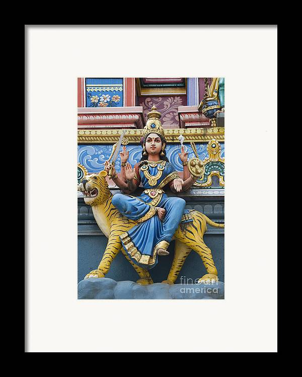 Durga Framed Print featuring the photograph Durga Statue On Hindu Gopuram by Tim Gainey