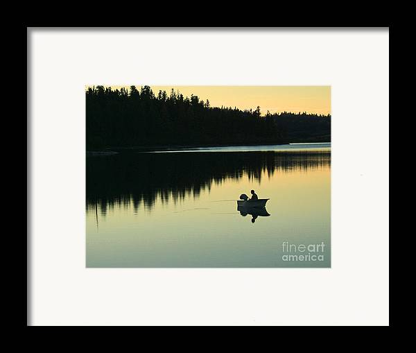 Fishing Framed Print featuring the photograph Fisherman At Dusk by Nancy Harrison