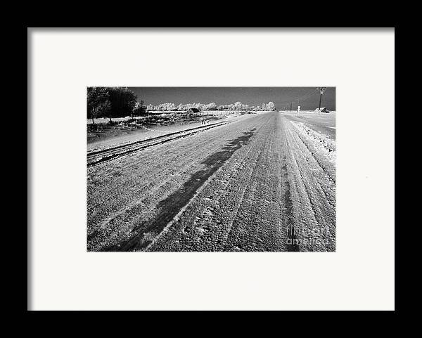 Salt Framed Print featuring the photograph frozen salt and grit covered rural small road in Forget Saskatchewan Canada by Joe Fox