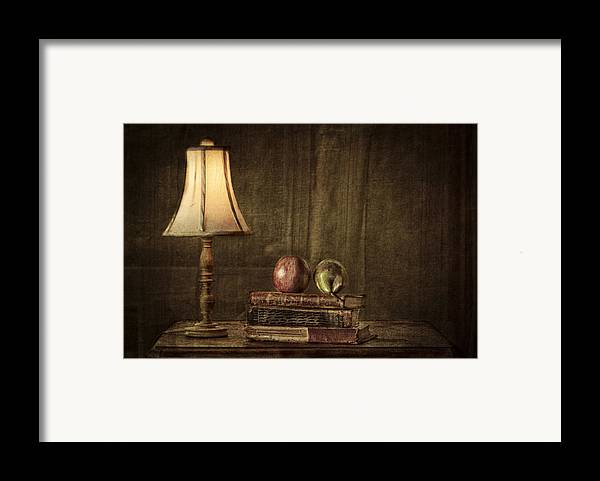 Apple Framed Print featuring the photograph Fruit And Books by Erik Brede
