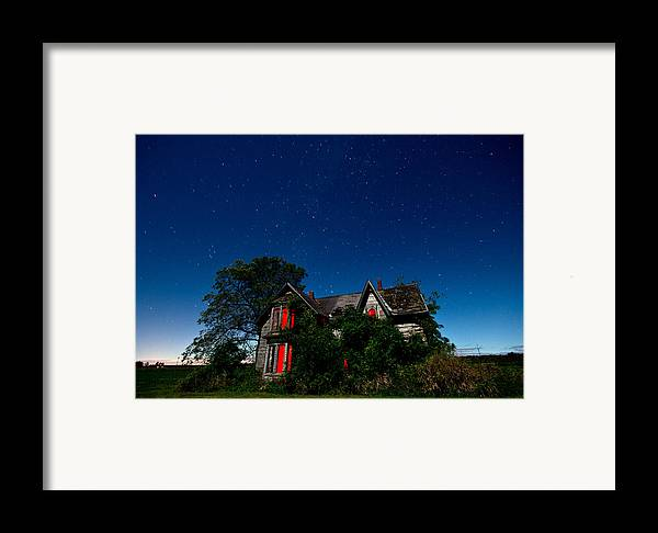 Abandoned Framed Print featuring the photograph Haunted Farmhouse At Night by Cale Best