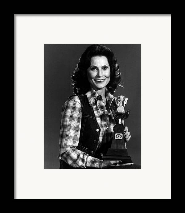 Retro Images Archive Framed Print featuring the photograph Loretta Lynn With Award by Retro Images Archive