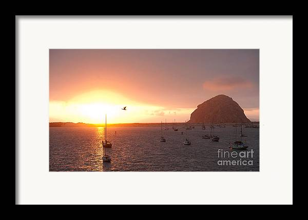 Morro Bay Ca Photographs Framed Print featuring the photograph Morro Bay Rock At Sunset by Artist and Photographer Laura Wrede