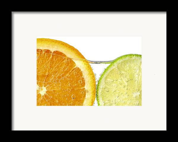 Orange Framed Print featuring the photograph Orange And Lime Slices In Water by Elena Elisseeva