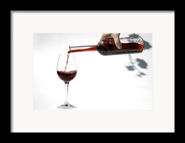 Alcohol Framed Print featuring the photograph Pouring Red Wine Into Glass by Patricia Hofmeester