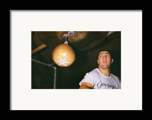 Marvin Newman Framed Print featuring the photograph Rocky Marciano by Retro Images Archive