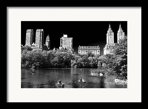 Rowing In Central Park Framed Print featuring the photograph Rowing In Central Park by John Rizzuto