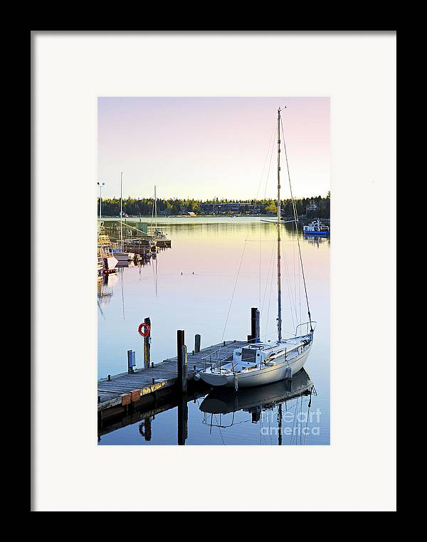 Boat Framed Print featuring the photograph Sailboat At Sunrise by Elena Elisseeva