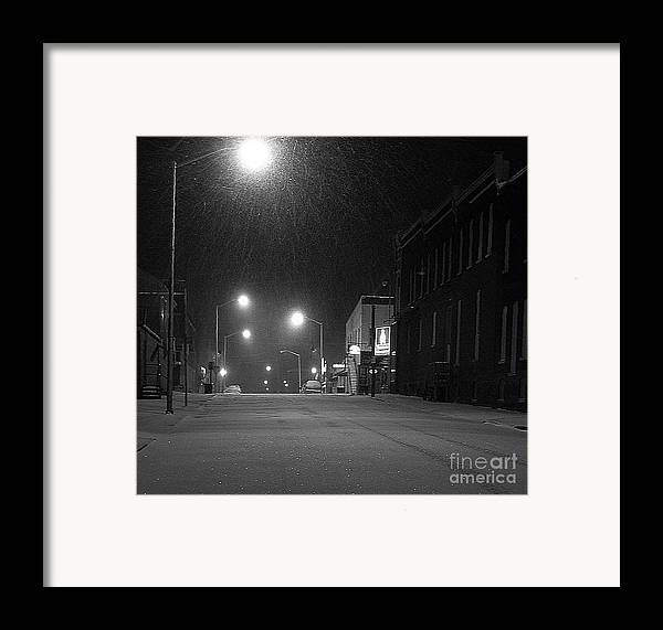 Black And White Photography Framed Print featuring the photograph Snowing On W. Fourth St. by Julie Dant