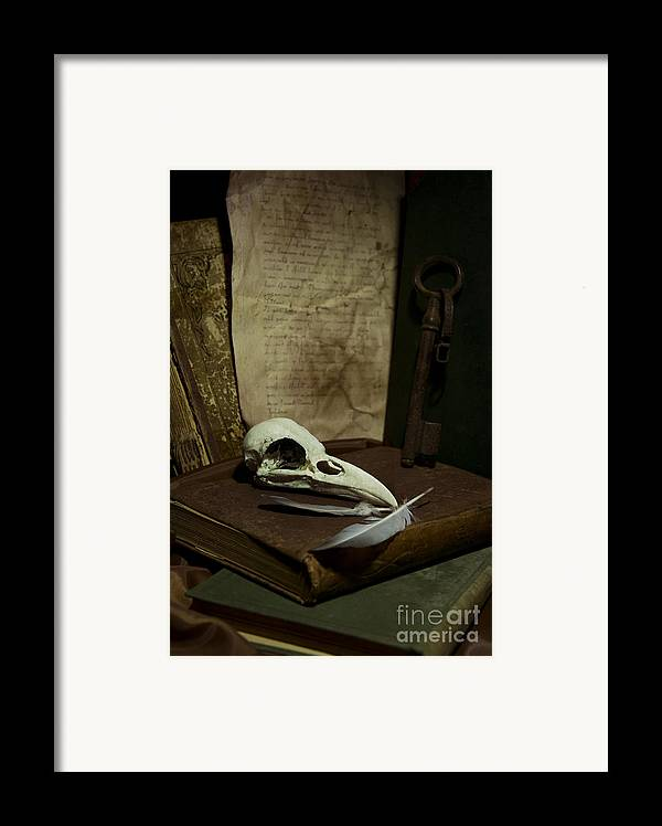 Still Life Framed Print featuring the photograph Still Life With Old Books Rusty Key Bird Skull And Feathers by Jaroslaw Blaminsky