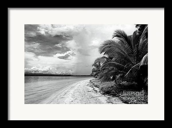 Storm Cloud On The Horizon Framed Print featuring the photograph Storm Cloud On The Horizon by John Rizzuto
