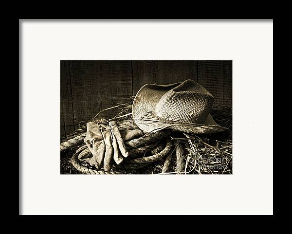 Bale Framed Print featuring the photograph Straw Hat With Gloves On A Bale Of Hay by Sandra Cunningham