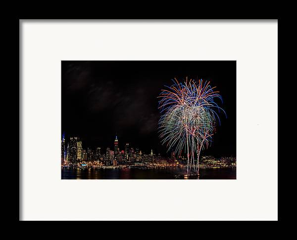 4th Of July Framed Print featuring the photograph The New York City Skyline Sparkles by Susan Candelario