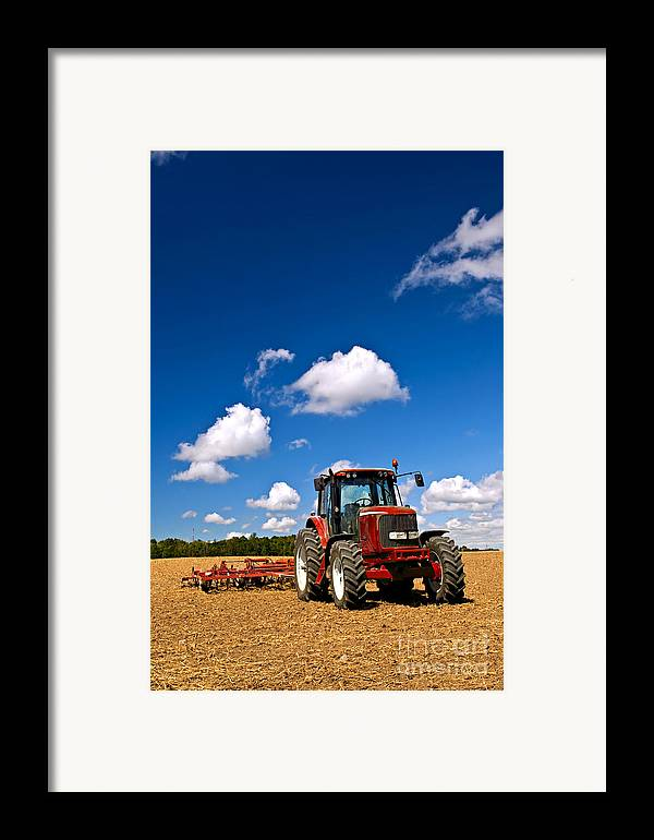 Tractor Framed Print featuring the photograph Tractor In Plowed Field by Elena Elisseeva