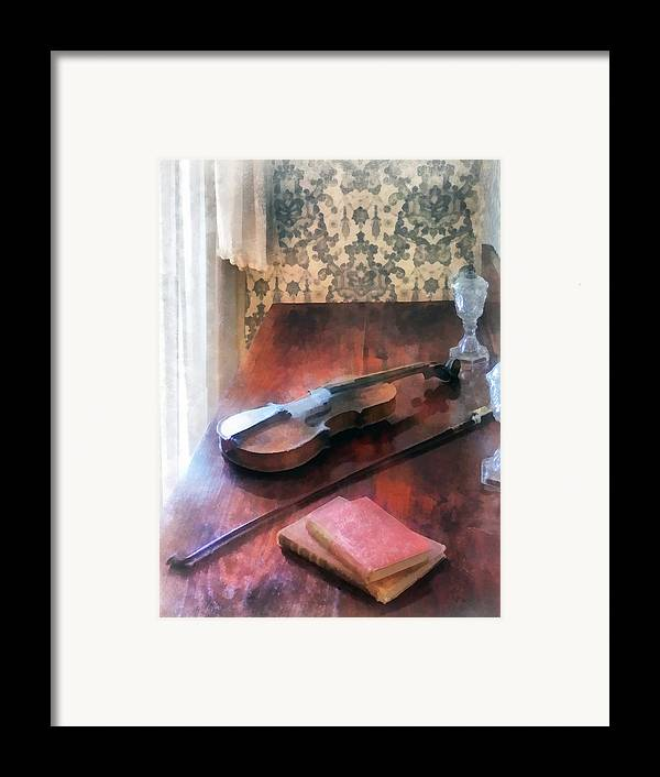 Violin Framed Print featuring the photograph Violin On Credenza by Susan Savad